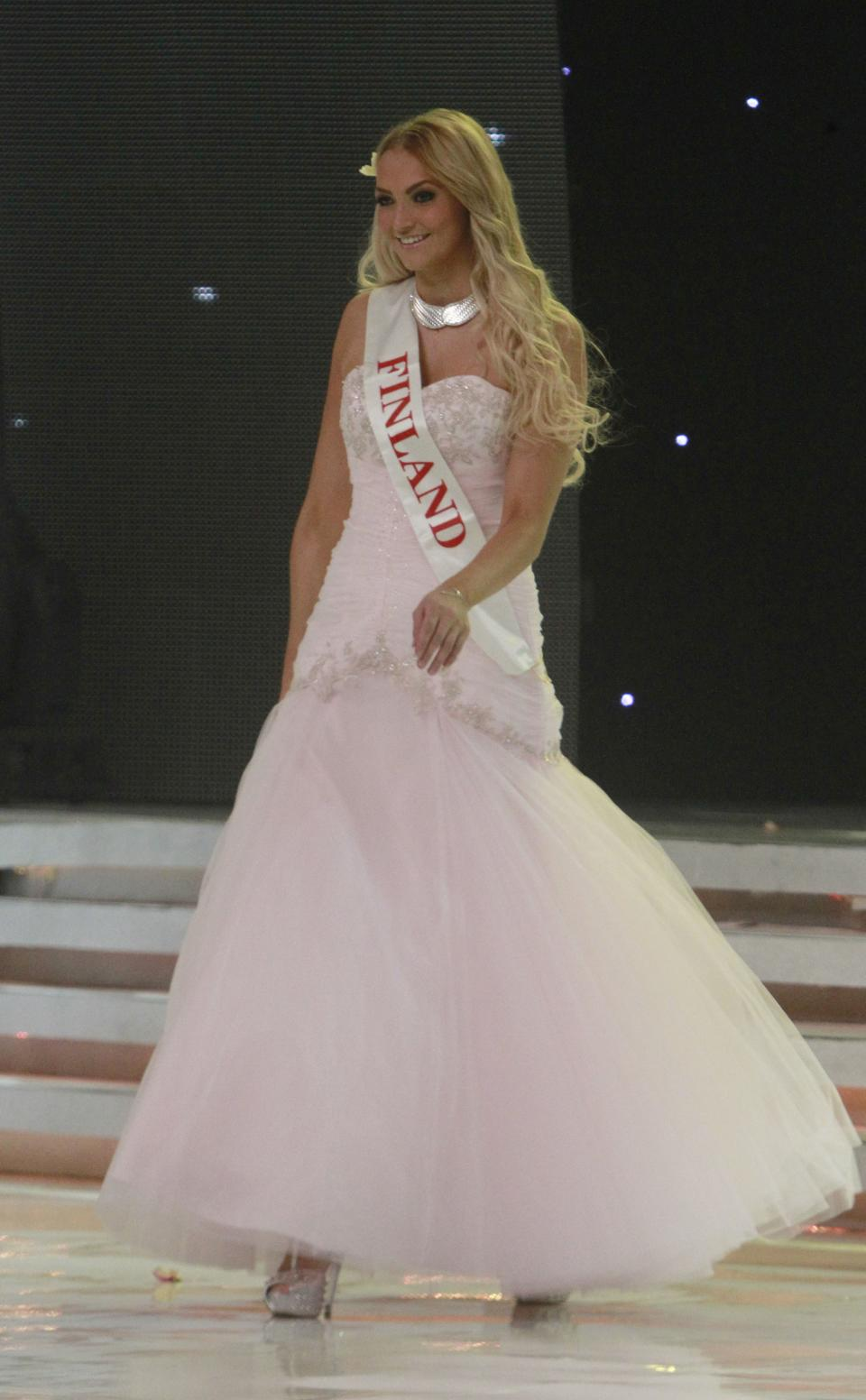 Miss Finland Maija Kerisalmi walks on stage during the opening of the 63rd Miss World Pageant ceremony in Nusa Dua, Bali, Indonesia on Sunday, Sept. 8, 2013. (AP Photo/Firdia Lisnawati)