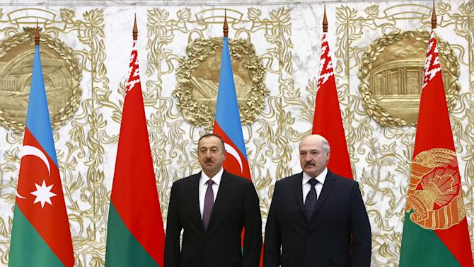 Belarus' President Lukashenko and his Azerbaijani counterpart Aliyev pose for a picture during their meeting in Minsk