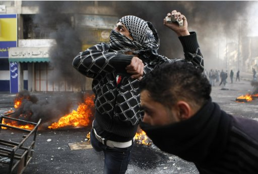 File picture of a Palestinian protester throwing stones during clashes with Israeli soldiers in Hebron