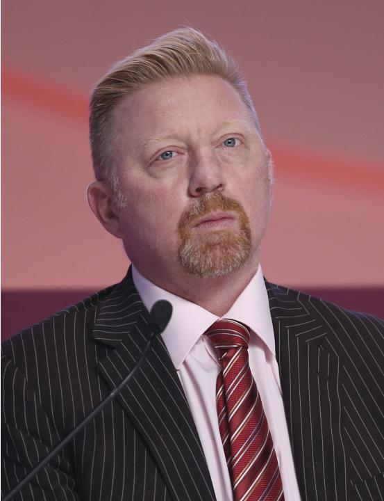 Former tennis player Boris Becker of Germany talks during the official opening ceremony of the Doha GOALS forum in Doha