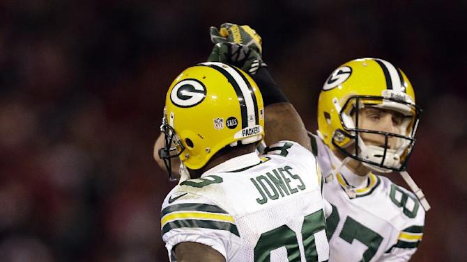 Green Bay Packers wide receiver James Jones (89) celebrates after scoring on a 20-yard touchdown reception with wide receiver Jordy Nelson (87) during the second quarter of an NFC divisional playoff NFL football game against the San Francisco 49ers in San Francisco, Saturday, Jan. 12, 2013. (AP Photo/Marcio Jose Sanchez)