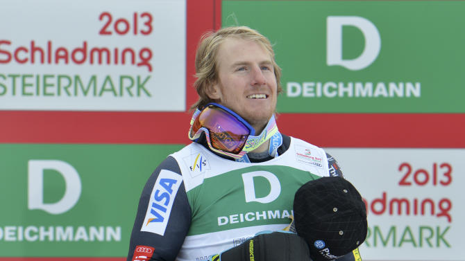 United States' TedLigety celebrates winning the gold medal after the second run of the men's giant slalom  at the Alpine skiing world championships in Schladming, Austria, Friday, Feb. 15, 2013. (AP Photo/Kerstin Joensson)
