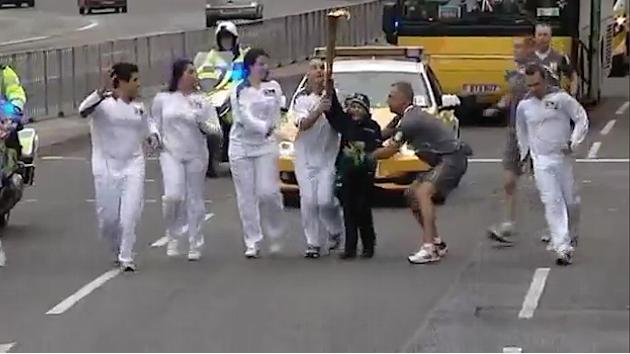 Kid nabs Olympic torch during relay
