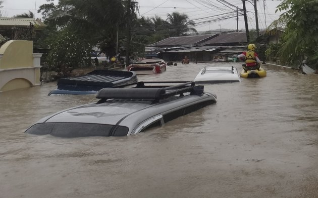 Vehicles are submerged in …