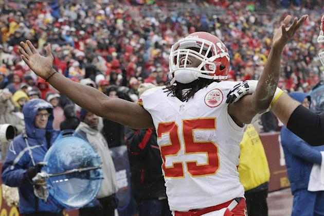 Kansas City Chiefs running back Jamaal Charles celebrates his touchdown during the first half of an NFL football game against the Washington Redskins in Landover, Md., Sunday, Dec. 8, 2013