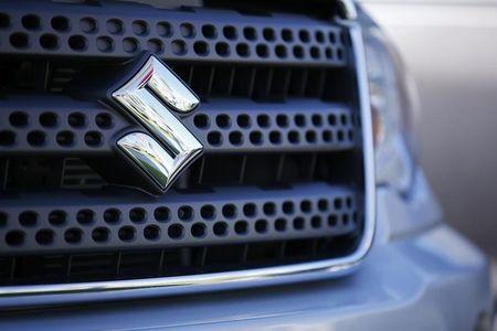A view shows the logo of a Suzuki truck for sale at a Suzuki dealership in National City