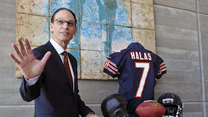 Chicago Bears NFL football team new head coach Marc Trestman poses in the lobby of Halas Hall after being introduced as the teams new head coach during a press conference Thursday, Jan. 17, 2013, in Lake Forest, Ill. (AP Photo/Jim Prisching)