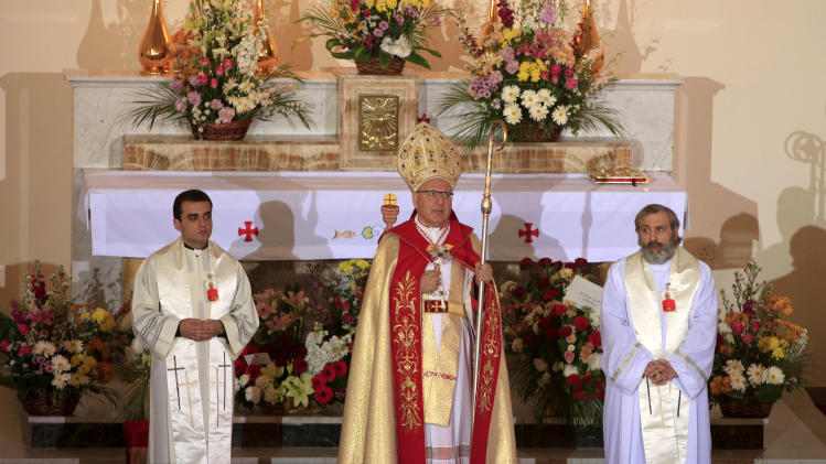 Louis Sako, 64, the new patriarch of Iraq's Chaldean Catholic Church, address the faithful during an enthroning ceremony at St. Joseph's Church in central Baghdad, Iraq, Wednesday, March 6, 2013. Iraq's Chaldean Catholic Church enthroned a new patriarch during a ceremonial mass Wednesday that was held amid tight security in Baghdad. (AP Photo/ Karim Kadim)