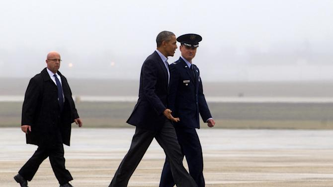 President Barack Obama, accompanied by the Vice Commander of 89th Airlift Wing Colonel Christopher M. Thompson, walks towards Air Force One before departure at Andrews Air Force Base, Md., Sunday, Nov. 29, 2015, en route to Paris where the president is to meet with other world leaders at the climate talks. (AP Photo/Jose Luis Magana)