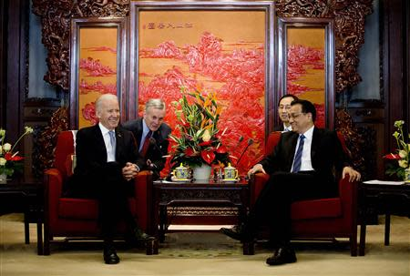 U.S. Vice President Joe Biden chats with Chinese Premier Li Keqiang during their meeting at the Zhongnanhai diplomatic compound in Beijing