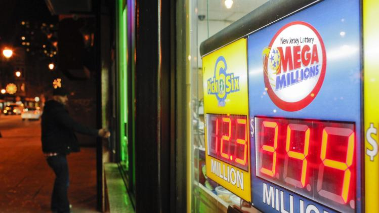 A customer arrives at a store where a Mega Millions sign is seen after the lottery grand prize rose to $344 million in New York