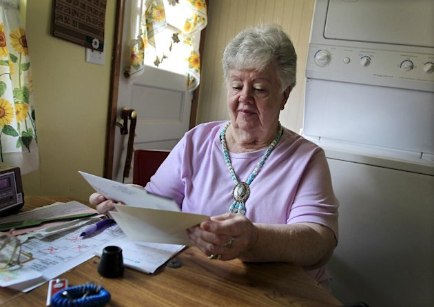 In this July 26, 2012, photo, Neta Homier looks over bills in her home in Toledo, Ohio. Homier says she relies on Social Security to pay her bills and while she is confident the program will continue to help her she fears it will not be able to rely on it. &quot;Social Security is whats carrying me,&quot; Homier said. &quot;It pays all my bills.&quot; People retiring today are part of the first generation of workers who have paid more in Social Security taxes during their careers than they will receive in benefits after they retire. Its a historic shift that will only get worse for future retirees, according to an analysis by The Associated Press. Previous generations got a much better bargain, mainly because payroll taxes were very low when Social Security was enacted in the 1930s and remained so for decades. (AP Photo/Carlos Osorio)