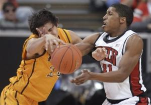 Moser leads No. 20 UNLV past Wyoming, 56-48