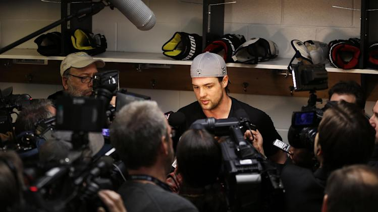 to the media following an NHL hockey practice Tuesday, March 11, 2014