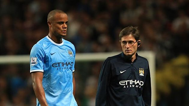 Manchester City's Vincent Kompany (left) is substituted off with an injury (PA Photos)