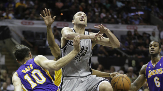 San Antonio Spurs' Manu Ginobili, center, of Argentina, loses control of the ball as Los Angeles Lakers' Steve Nash (10) defends against him during the first half of Game 2 of a first-round NBA basketball playoff series on Wednesday, April 24, 2013, in San Antonio, Texas. (AP Photo/Eric Gay)