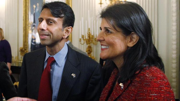 South Carolina Gov. Nikki Haley, right, and Louisiana Gov. Bobby Jindal stand together before President Barack Obama addressed the National Governors Association in the State Dining Room of the White House in Washington, Monday, Feb. 25, 2013. (AP Photo/Charles Dharapak)