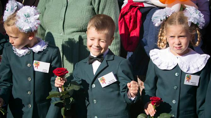 First-grade pupils attend a festive ceremony to mark the beginning of another academic year in Makiivka