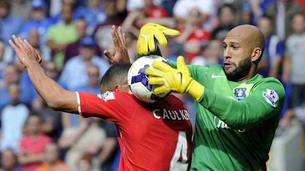Everton goalkeeper Tim Howard grabs the ball (Reuters)