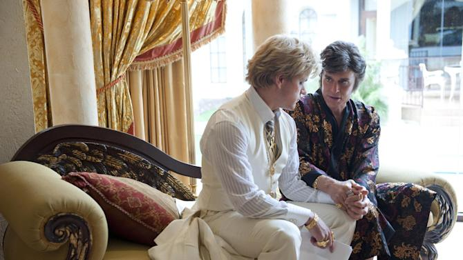 """This film image released by HBO shows Michael Douglas, right, as Liberace, and Matt Damon, as Scott Thorson in a scene from """"Behind the Candelabra,"""" premiering Sunday at 9 p.m. EDT on HBO. (AP Photo/HBO, Claudette Barius)"""