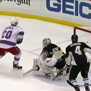 Kreider pounces on a puck off the backboards