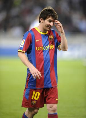 Barcelona's Lionel Messi from Argentina reacts during a Spanish La Liga soccer match against Real Sociedad at Anoeta stadium in San Sebastian northern Spain, Saturday, April 30, 2011. (AP Photo/Saez Miren)