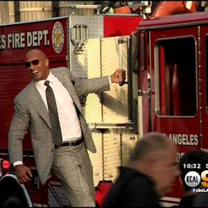 The Rock Rolls In To 'San Andreas' Premiere On Fire Truck