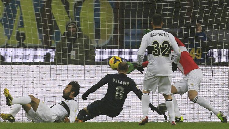 Inter Milan's Palacio shoots to score against Parma during their Italian Serie A soccer match in Milan