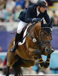 Germany's Michael Jung riding Sam competes in the team Show Jumping phase of the Eventing competition of the 2012 London Olympics at the Equestrian venue in Greenwich Park, London on July 31, 2012. AFP PHOTO / ADRIAN DENNIS