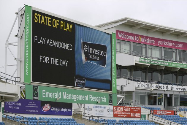 The scoreboard shows that play has been abandoned for the day at the second test cricket match between England and New Zealand at Headingley cricket ground in Leeds