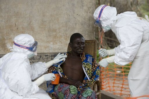 <p>Nurses wearing protective clothing take care of a patient with Ebola haemorrhagic fever in Kampungu. An outbreak of Ebola fever in the Democratic Republic of Congo may have claimed up to 32 lives since May, according to the World Health Organisation.</p>