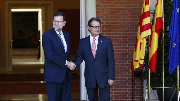Spanish Prime Minister Rajoy meets with Catalan President Mas at the Moncloa Palace in Madrid
