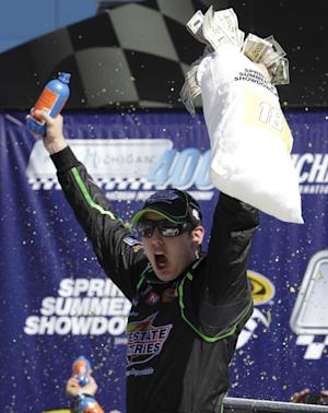 Kyle Busch celebrates his victory in the NASCAR Sprint Cup Series auto race at Michigan International Speedway in Brooklyn, Mich., Sunday, Aug. 21, 2011. (AP Photo/Paul Sancya)
