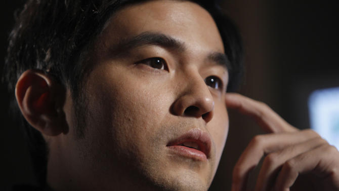 """In this Thursday, Dec. 1, 2011 photo, Taiwan pop star Jay Chou speaks during an interview in Taipei, Taiwan. Chou released """"Wow,"""" his 11th Mandarin album on Nov. 11, and 2011 marks his 11th year in show business. """"I've made a lot of more sophisticated tracks in the last 10 albums. There were a lot of songs that adults love. The 11th album is more for the kids,"""" Cho said. (AP Photo/Wally Santana)"""