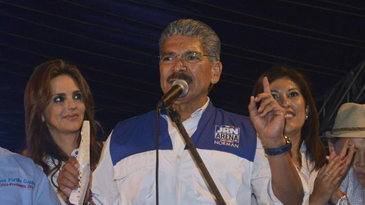 Norman Quijano, presidential candidate of the conservative Alianza Republicana Nacionalista (ARENA), speaks to his supporters during a political rally in San Salvador