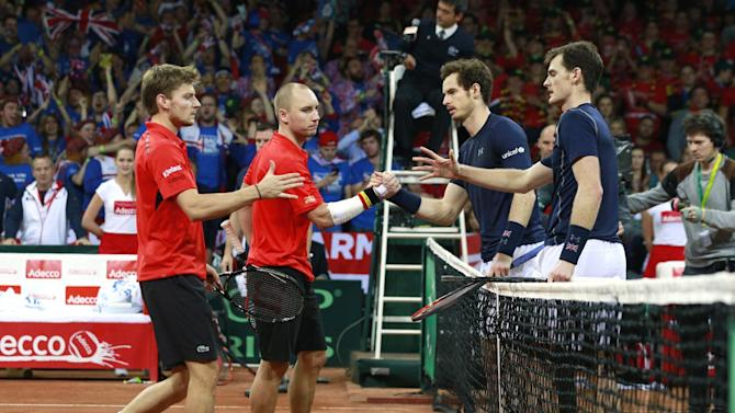 Men's Doubles - Great Britain's Andy Murray and Jamie Murray shake hands with Belgium's Steve Darcis and David Goffin after winning their match