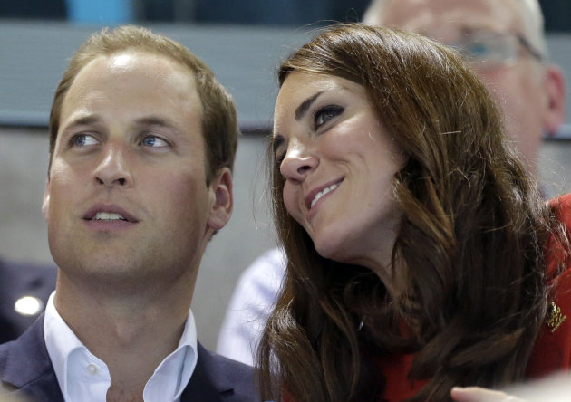 Britain's Prince William, left, and wife Kate, Duke and Duchess of Cambridge watch swimming finals at the Aquatics Centre in the Olympic Park during the 2012 Summer Olympics in London, Friday, Aug. 3, 2012. (AP Photo/Lee Jin-man)