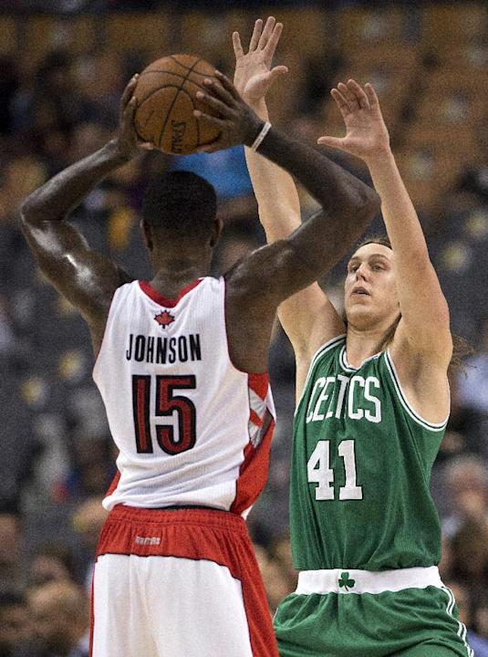 Boston Celtics Kelly Olynyk (41) guards Toronto Raptors Amir Johnson during the first half of a preseason NBA basketball game in Toronto on Wednesday, Oct. 16, 2013