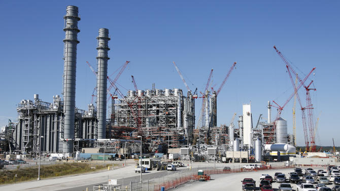 To clean up coal, Obama pushes more oil production