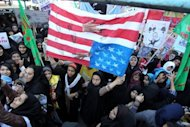 Iranian women protest outside the former US embassy in Tehran during a rally in 2011 to mark the storming of the embassy by students. Actor-director Ben Affleck's latest movie tells the incredible story of Hollywood's role in an attempt to get a group of US diplomats out of Iran during the 1979 hostage crisis