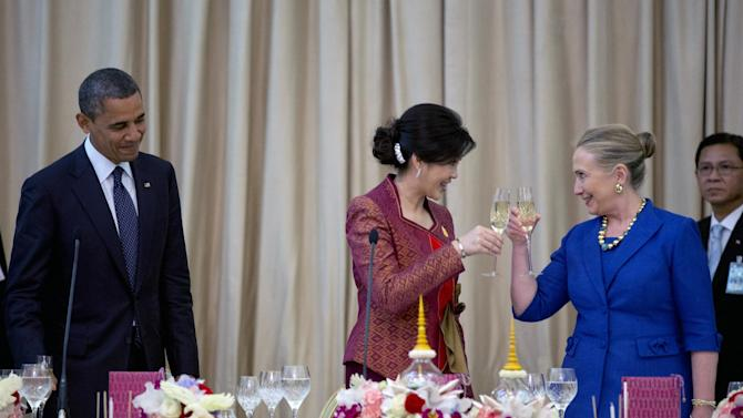 U.S. President Barack Obama looks on from left, as U.S. Secretary of State Hillary Rodham Clinton, right, toasts with Thai Prime Minister Yingluck Shinawatra during an official dinner at Government House in Bangkok, Thailand, Sunday, Nov. 18, 2012. (AP Photo/Carolyn Kaster)