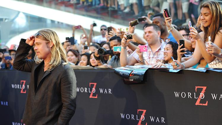 "Actor Brad Pitt attends the premiere of ""World War Z"" in Times Square on Monday, June 17, 2013 in New York. (Photo by Evan Agostini/Invision/AP)"