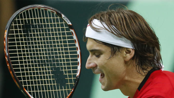 Spain's David Ferrer celebrates after defeating Czech republic's Tomas Berdych during their Davis Cup finals tennis singles match in Prague, Czech Republic, Sunday, Nov. 18, 2012. Ferrer defeated Berdych and tied the match with Czech Republic 2-2. (AP Photo/Petr David Josek)