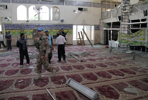 UN observers inspect the prayer hall of the Sayyida Zeinab shrine which was damaged after a car bomb exploded near the shrine, in a suburb of Damascus, Syria, Thursday June 14, 2012. A car bomb exploded Thursday in a Damascus suburb that is home to a popular Shiite Muslim shrine, wounding at least two people, Syria's state-run news agency SANA reported, while activists said regime troops continued shelling rebellious areas in central Homs province. (AP Photo/Bassem Tellawi)