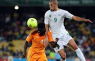 Ivory Coast defender Kolo Toure vies with Algeria forward Islam Slimani during a 2013 African Cup of Nations Group D match in Rustenburg on January 30, 2013 at Royal Bafokeng Stadium. Ivory Coast scored twice inside four minutes to snatch a 2-2 draw with Algeria.