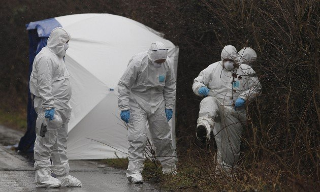Police forensic officers search on Ox Hey Lane in Bolton after the body of a baby was discovered