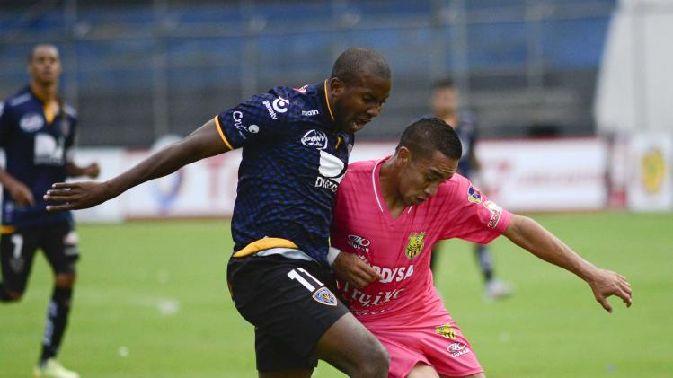 Solis of Ecuador's Independiente fights for the ball with an unidentified player of Venezuela's Trujillanos during their Copa Sudamericana soccer match in Quito