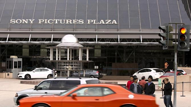 "Cars drive by the Sony Pictures Plaza building in Culver City, Calif., Friday, Dec. 19, 2014. President Barack Obama declared Friday that Sony ""made a mistake"" in shelving the satirical film, ""The Interview,"" about a plot to assassinate North Korea's leader. He pledged the U.S. would respond ""in a place and manner and time that we choose"" to the hacking attack on Sony that led to the withdrawal. The FBI blamed the hack on the communist government. (AP Photo/Damian Dovarganes)"