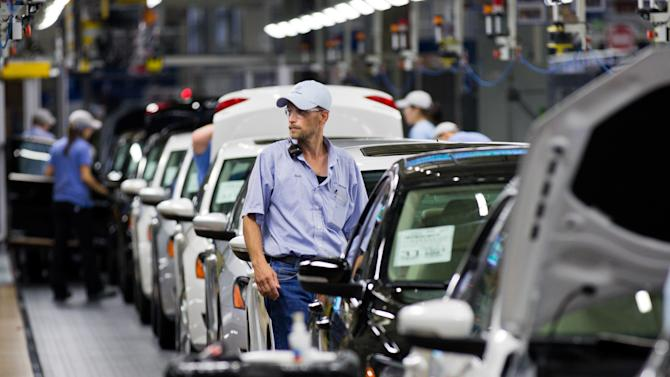 FILE - In this July 31, 2012 file photo, an employees at the Volkswagen plant in Chattanooga, Tenn., works on a Passat sedan. A three-day election on whether workers will be represented by the United Auto Workers union concludes on Friday, Feb. 14, 2014. (AP Photo/Erik Schelzig, file)