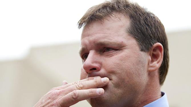 Former Major League Baseball pitcher Roger Clemens holds back tears as he talks to the media outside federal court in Washington, Monday, June 18, 2012, after his acquittal on charges of lying to Congress in 2008 when he denied ever using performance-enhancing drugs. (AP Photo/Manuel Balce Ceneta)